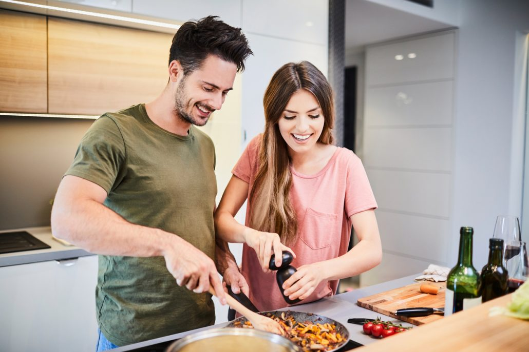 couple making dinner in the kitchen